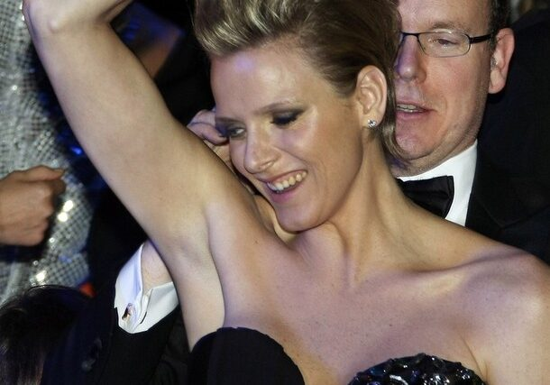 Prince Albert II of Monaco (R) dances with his friend Charlene Wittstock during the Bal de la Rose in Monte Carlo March 28, 2009. The Bal de la Rose is a traditional annual charity event in aid of the Foundation Princess Grace. REUTERS/Eric Gaillard (MONACO ROYALS SOCIETY)