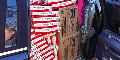This undated photo released by the Bureau of Alcohol, Tobacco, Firearms and Explosives shows a vehicle agents from the ATF and the Maryland Comptroller's office stopped on Interstate 95 in February 2005, recovering 1,600 cartons of cigarettes from the vehicle. ATF agents in Virginia have more aggressively pursued cigarette smugglers in the recent years in response to increased activity. (AP Photo/ATF)